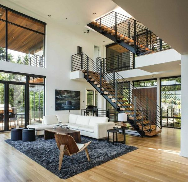 Double-Height Sitting Area Near The Main Stairwell In This Home Located In Portland, Oregon