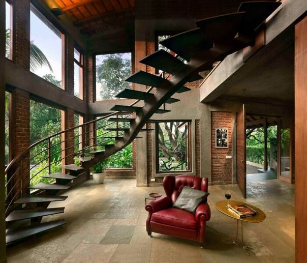 Unique Entrance To A Brick Residence Surrounded By Old Mango Trees Featuring A Twisting Steel Staircase In Alibag Near Mumbai, India