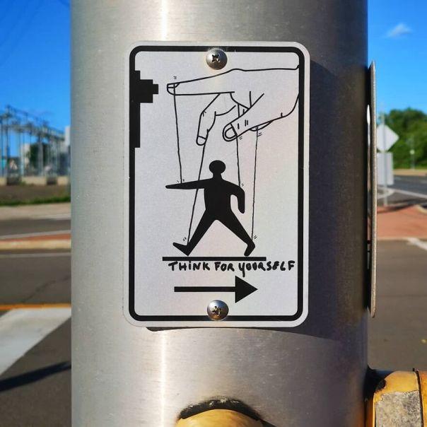 """Think For Yourself"" #moncton #canada #inspire #oakoak #streetart #urbanart #oaky #oakycan #trafficsign #muppet #power #think #doigt #art #funny #mtn94 #montana94 #panneau #marionnette #pantin"