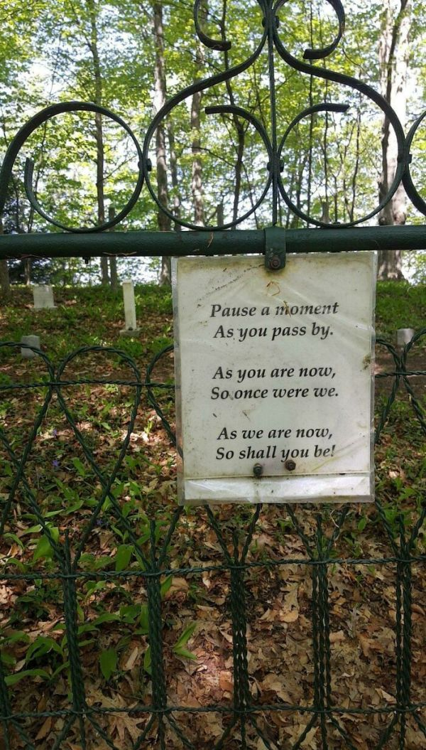 Very Humbling Sign Posted Outside A Cemetery In The Middle Of The Woods