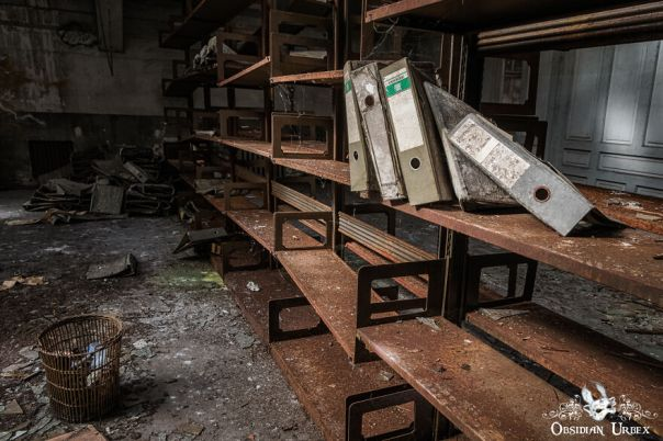 Only A Few Scraps Of The Paperwork Remain, On Shelves That Are Mainly Empty