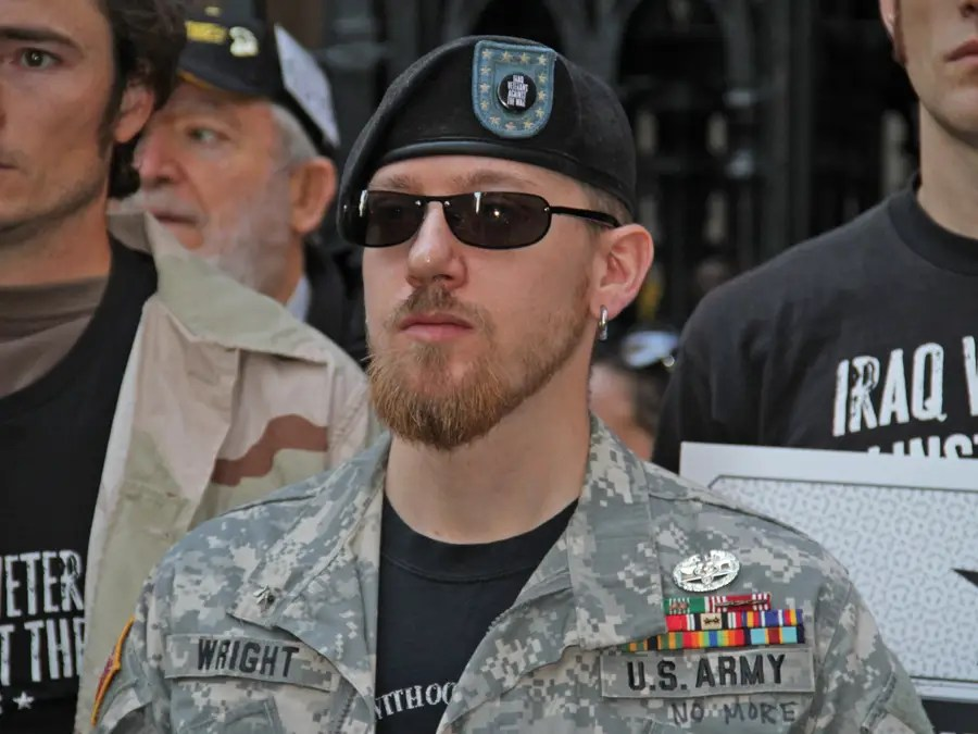 all types of vets were marching this former soldier was pushing his daughter in a stroller Veterans Stand Up For Liberty: If You Continue To Assemble In Peace And Solidarity, Justice Will Come To Pass