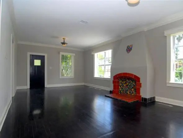 Most of the house has a clean white interior, with flashes of color.