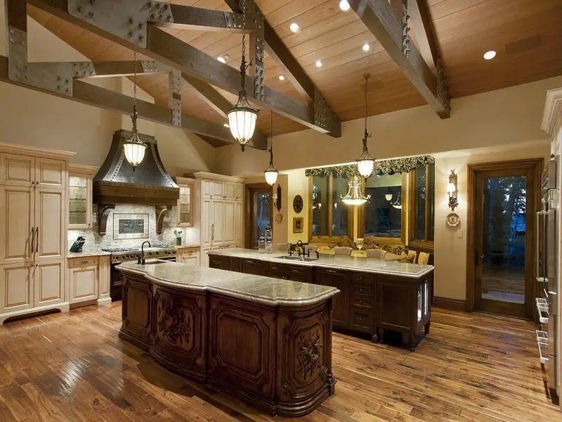 The home has eight bedrooms, eight full bathrooms, and four half baths. The listing touts the home's wet bar, ski prep room, game room, and steam room.