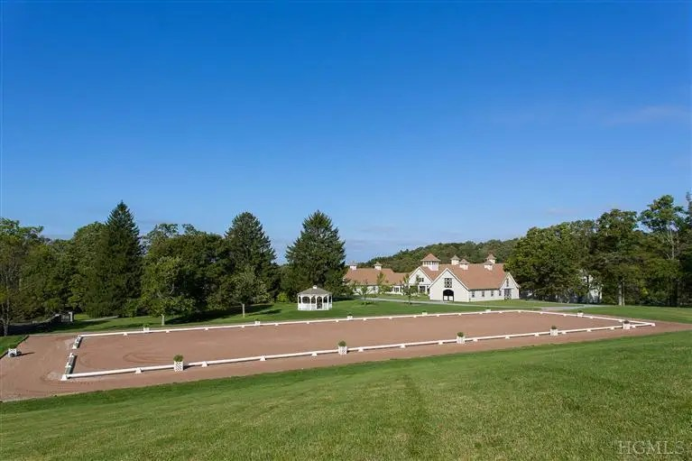 This Millbrook, New York farm is listed for $14.95 million, and boasts both indoor and outdoor training facilities, a pool with a pool house, and a guest house.