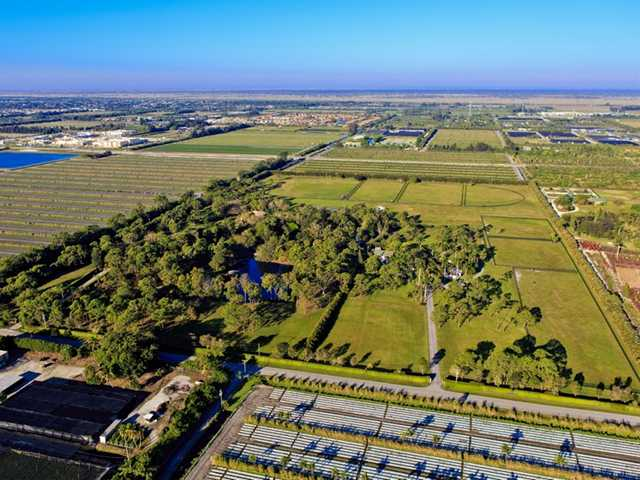 This farm in Delray Beach, Florida is listed for $13.9 million. It sits on a 60-acre lot, and has all the advantages of living in Florida, including golf, large airports, and good food.