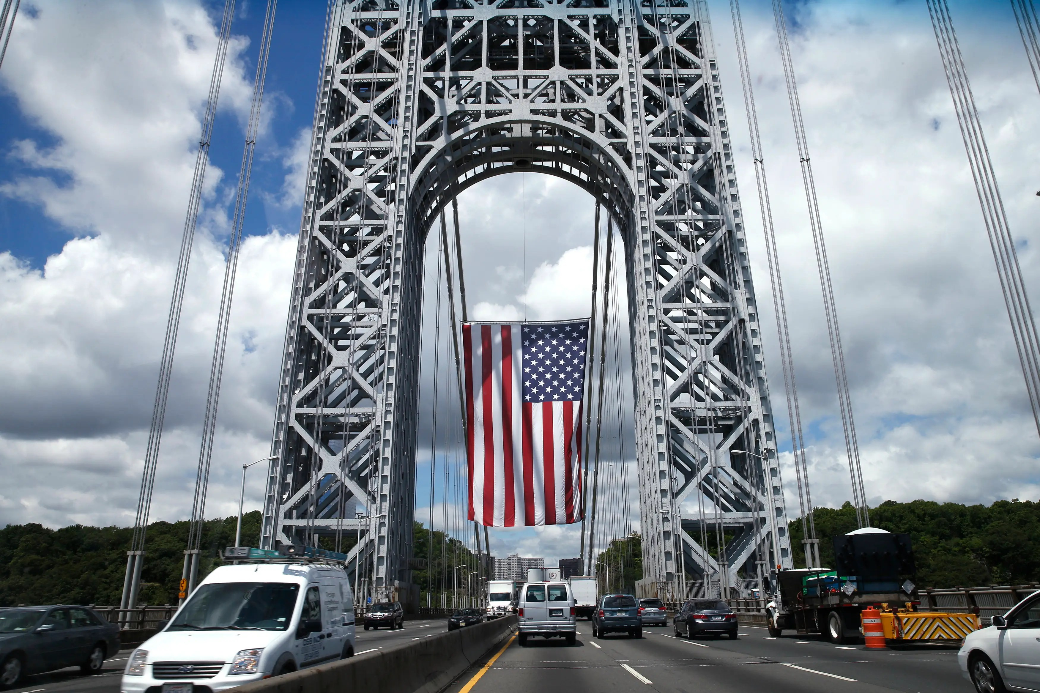 Business Insider photo of a giant flag suspended at the George Washington Bridge between New York City and New Jersey, on September 2, 2013
