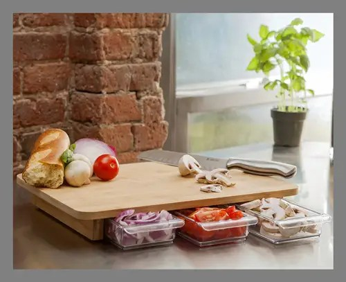 The 25 best kitchen gadgets you can buy for under  25   Business Insider A cutting board that comes with its own storage