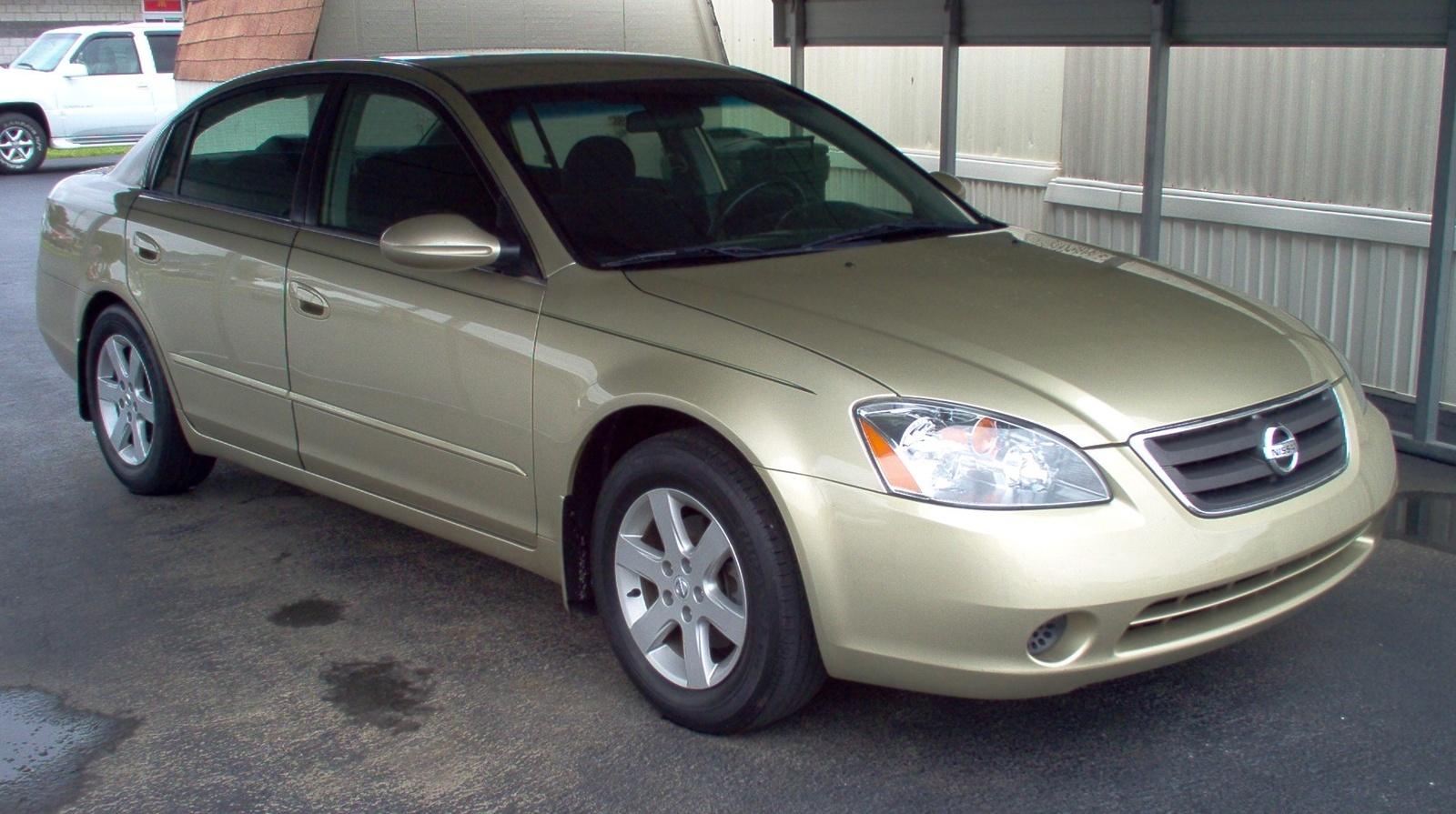 2003 White Altima Nissan
