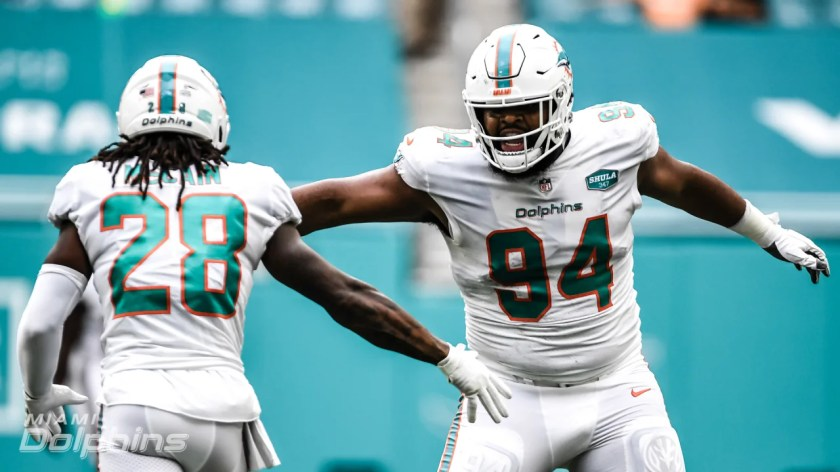 Safety Bobby McCain (28) celebrates with Defensive tackle Christian Wilkins (94) during a Week 4 NFL football game against the Seattle Seahawks on Sunday, October 4th, 2020 at Hard Rock Stadium in Miami Gardens, FL. (Miami Dolphins)
