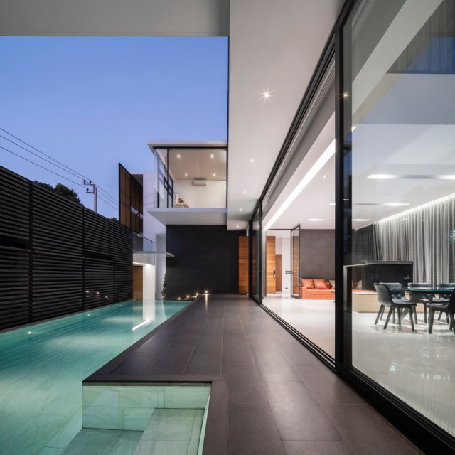 archimontage screens house from the street to achieve privacy in bangkok