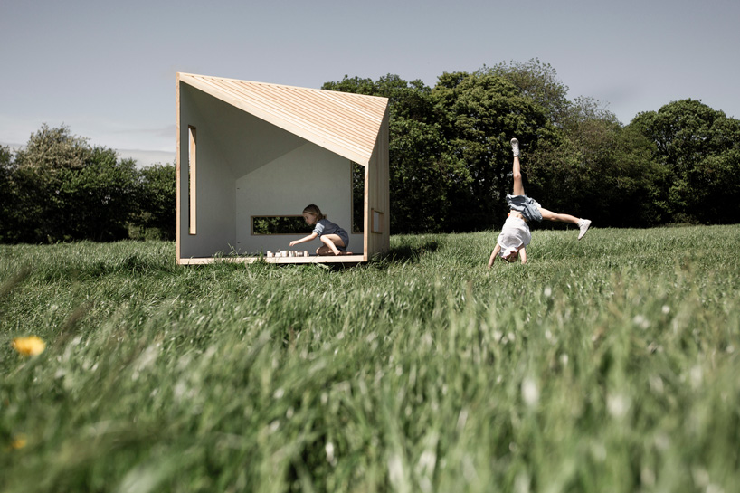 koto prefabricates the 'ilo playhouse' for children using larch timber and recycled rubber designboom
