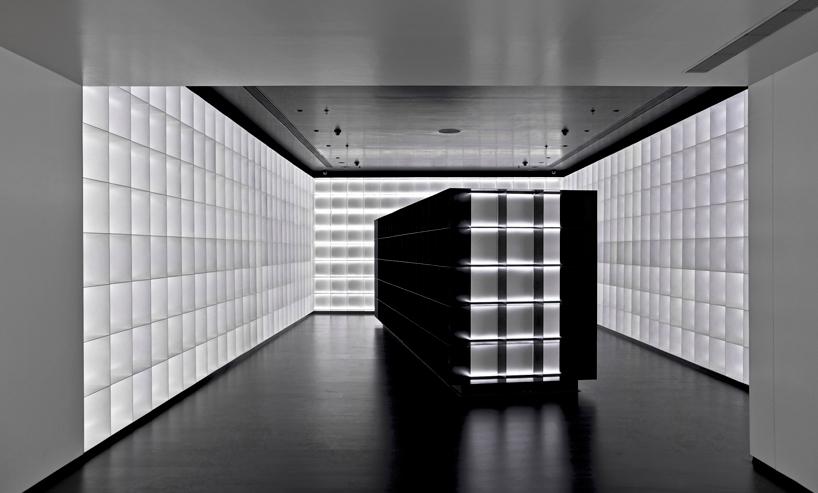 iksoi design studio creates monochromatic interior for liquor store in india