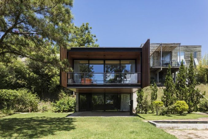 jobim carlevaro arquitetos finishes hotel suite in brazil with movable façade of wooden slats