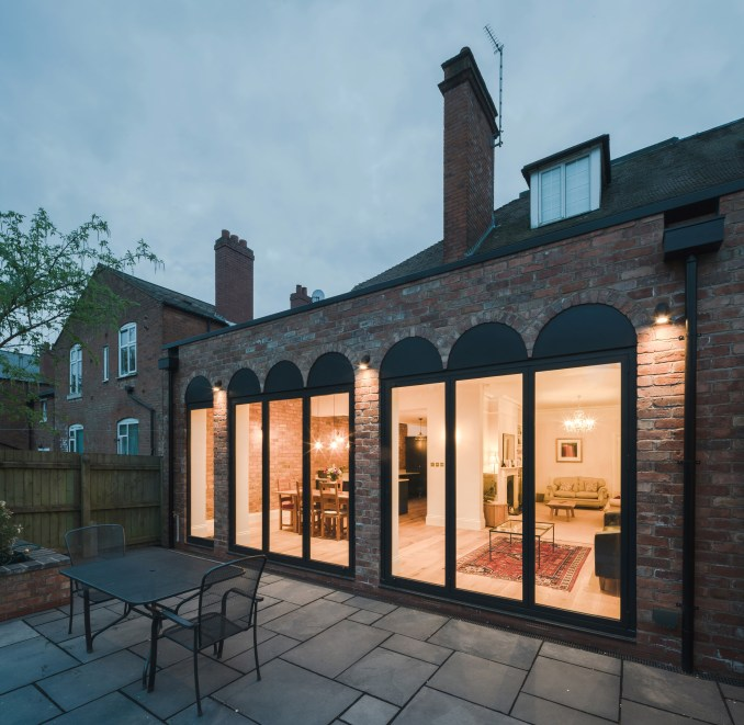 Colonnade-like Glazing Fronts Birmingham House Extension