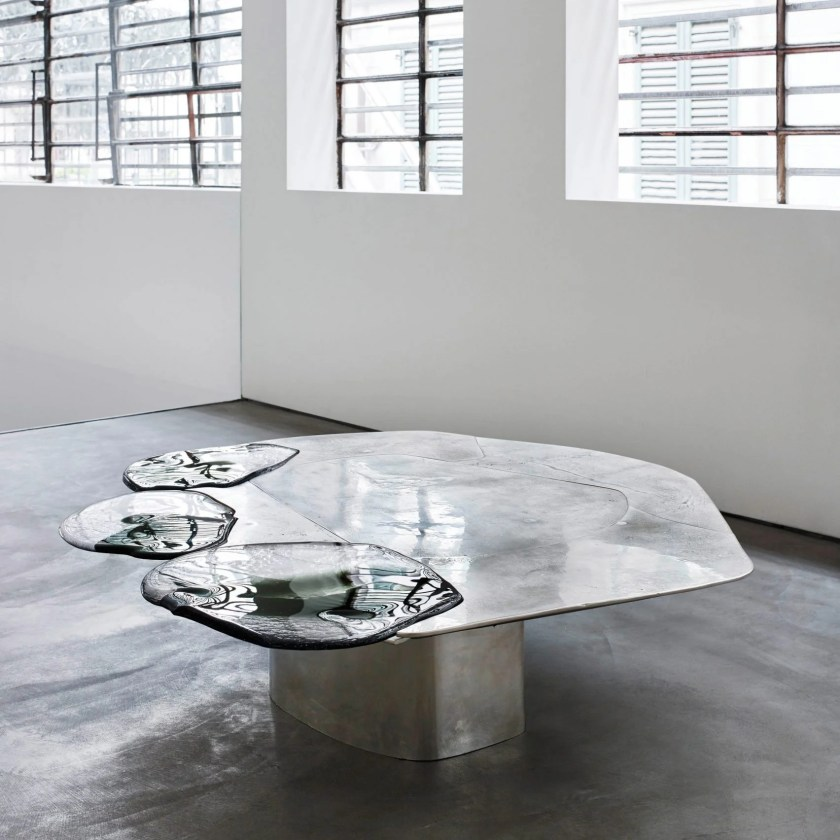 marble, silvered cast brass and Murano glass with industrial components like fiberglass.