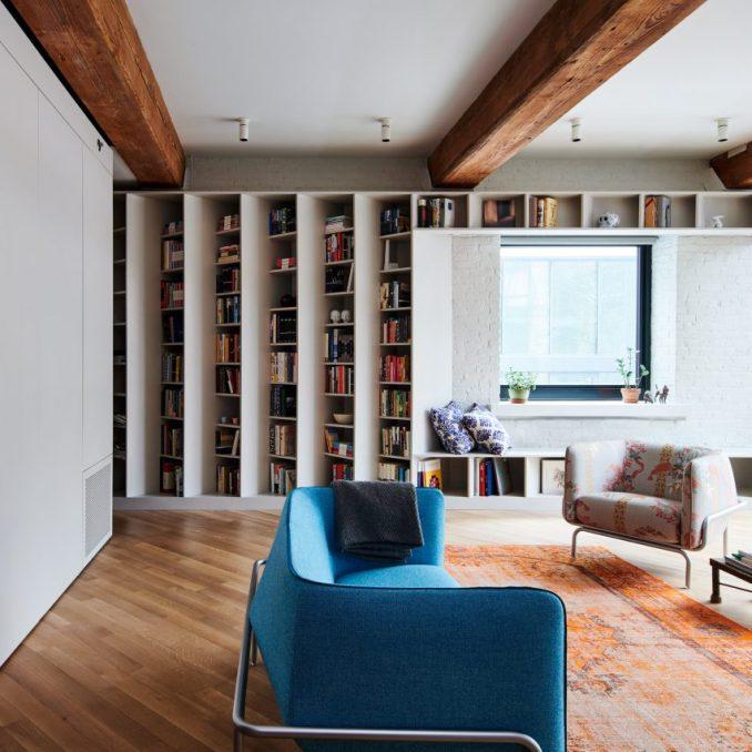 Angled Bookshelves Define Publisher's Loft By Buro Koray
