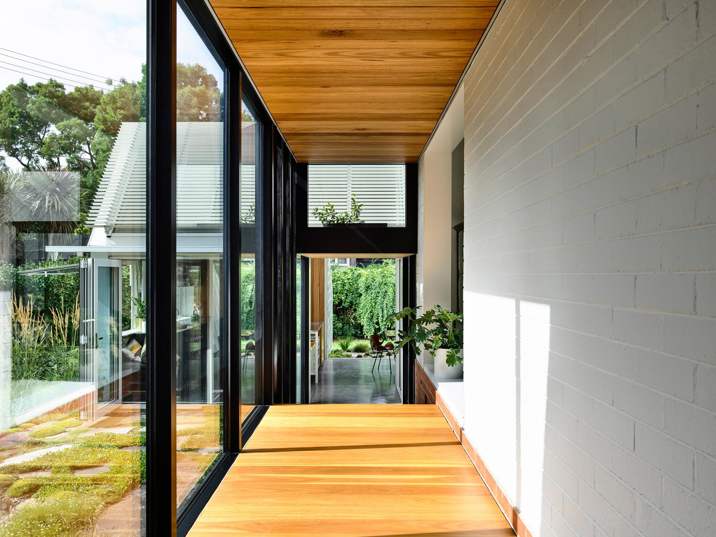 Empire House by Austin Maynard Architects glazed corridor