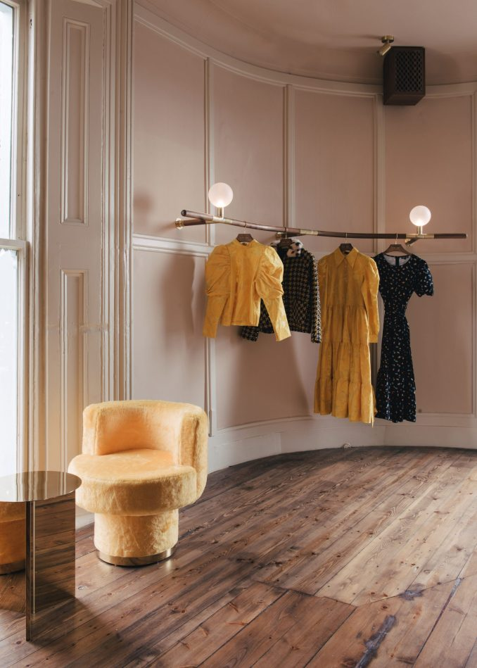 Sister Jane Townhouse by Sella Concept has a clothes showroom on the first floor