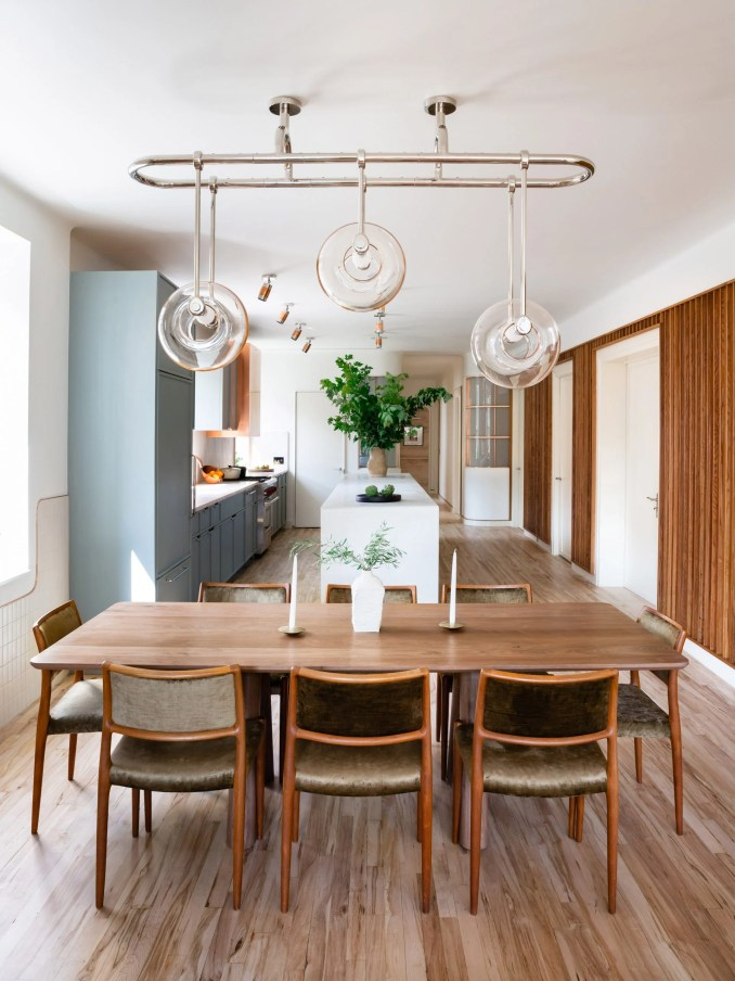 Dining area of 20 Bond apartment by Home Studios