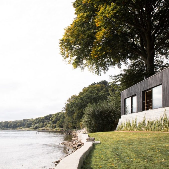 Fjord Boat House by Norm Architects features black-timber facade