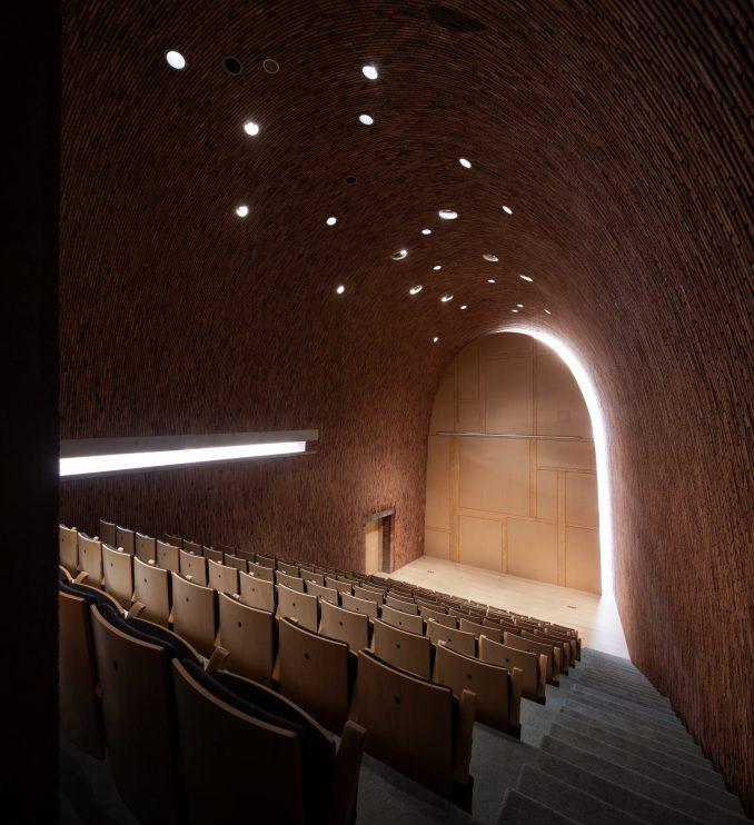 An auditorium inside Jingdezhen Imperial Kiln Museum by Studio Zhu-Pei