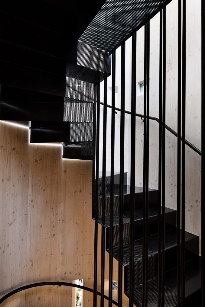 Part-perforated black steel staircase