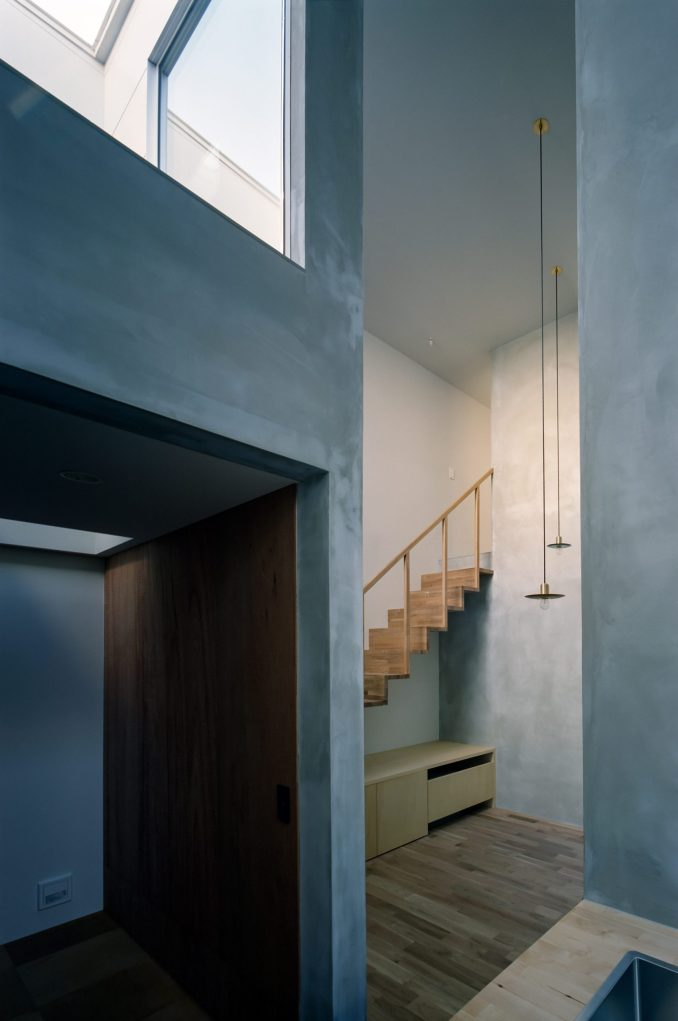 Cement covered walls in house by FujiwaraMuro Architects