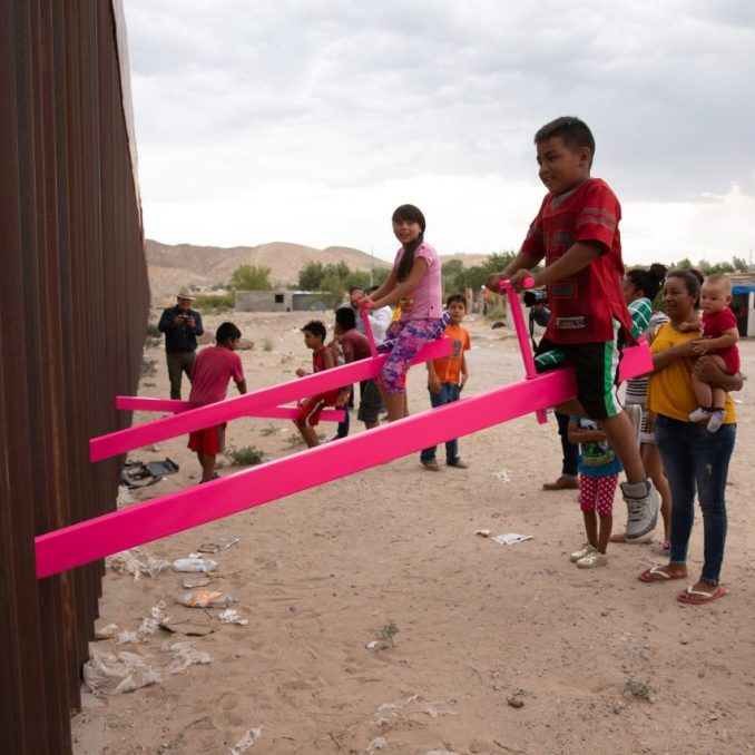 Pink seesaw installation on the US-Mexico border