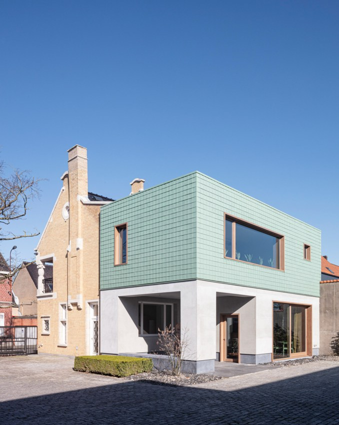 Grey plaster and copper cladding provides a contrast