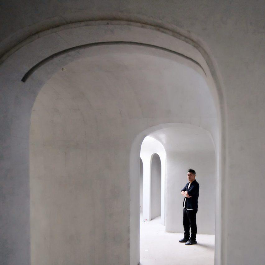 Portrait of Ma Yansong in a white-concrete building