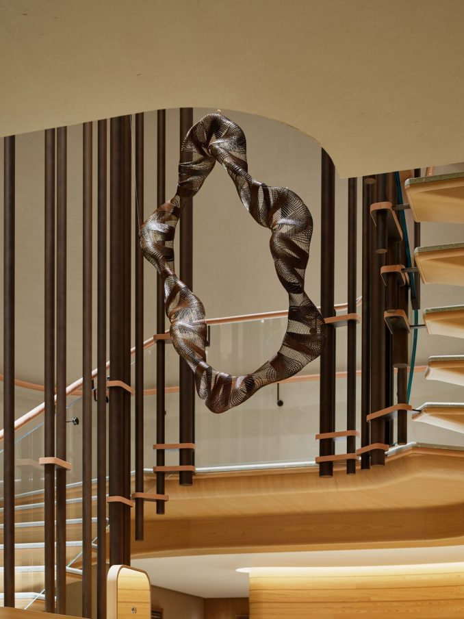 A suspended sculpture in a staircase