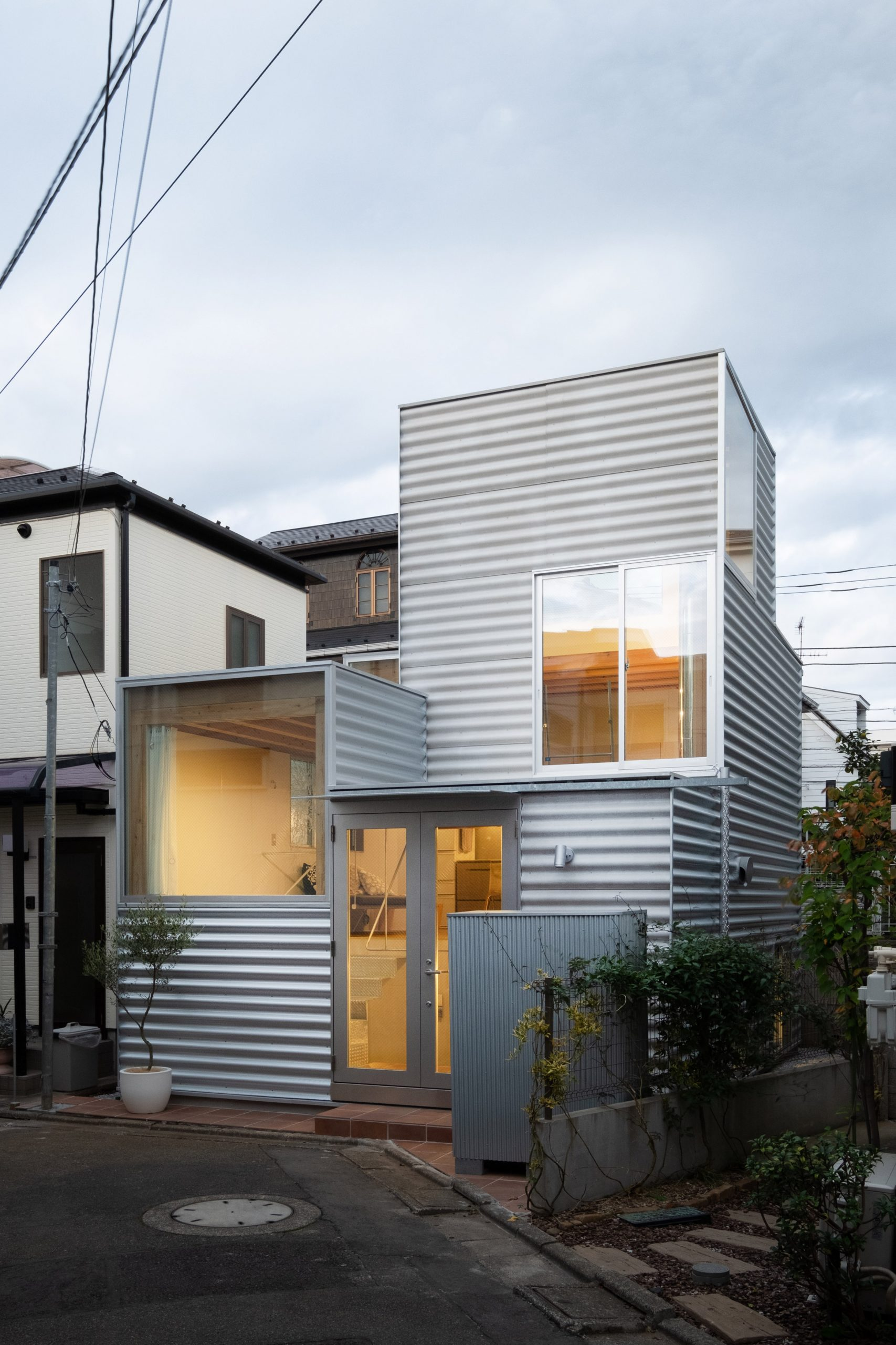 Stacked-box house with iron-clad facade