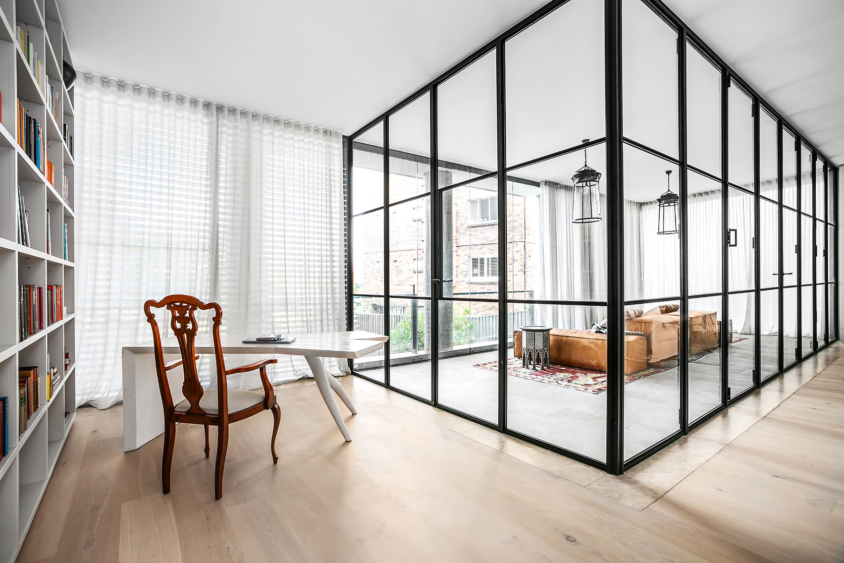 Steel and glass room within a room