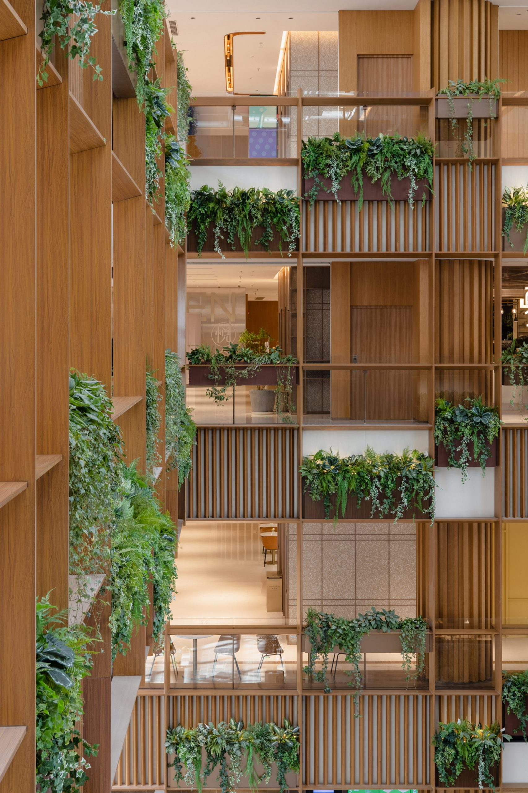 Hanging plants in Xintiandi atrium by AIM Architecture