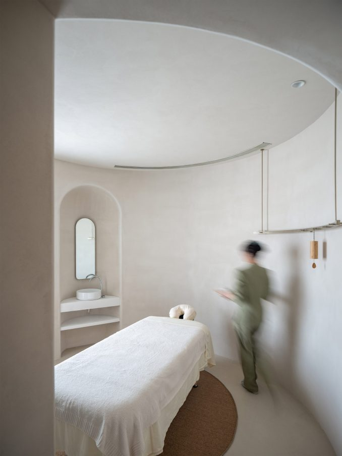 A spa bed is located in the centre of a treatment room at Soul Realm Spa