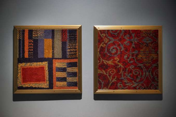 Framed textiles from pub furniture