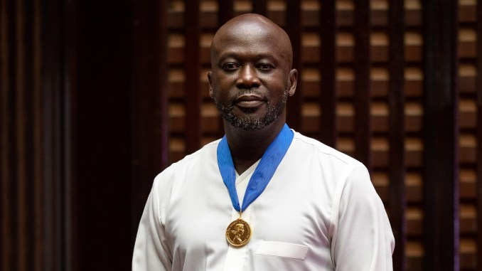 David Ajdaye wearing Royal Gold Medal