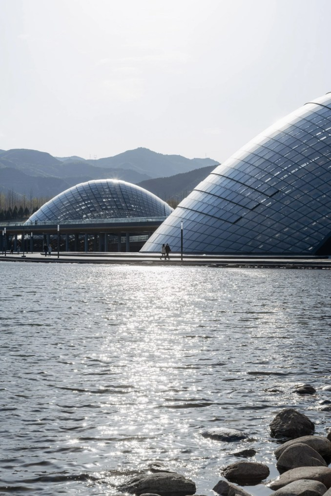 The domed greenhouses at Taiyuan Botanical Garden are located by a lake