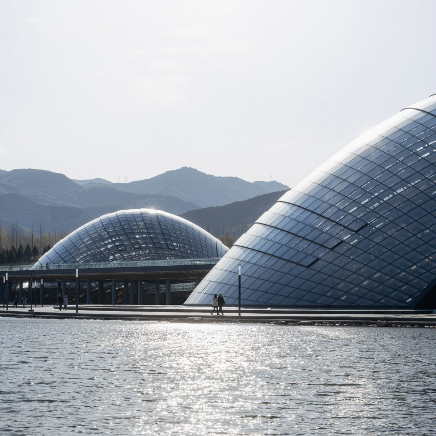 Domed greenhouses were built by an artificial lake