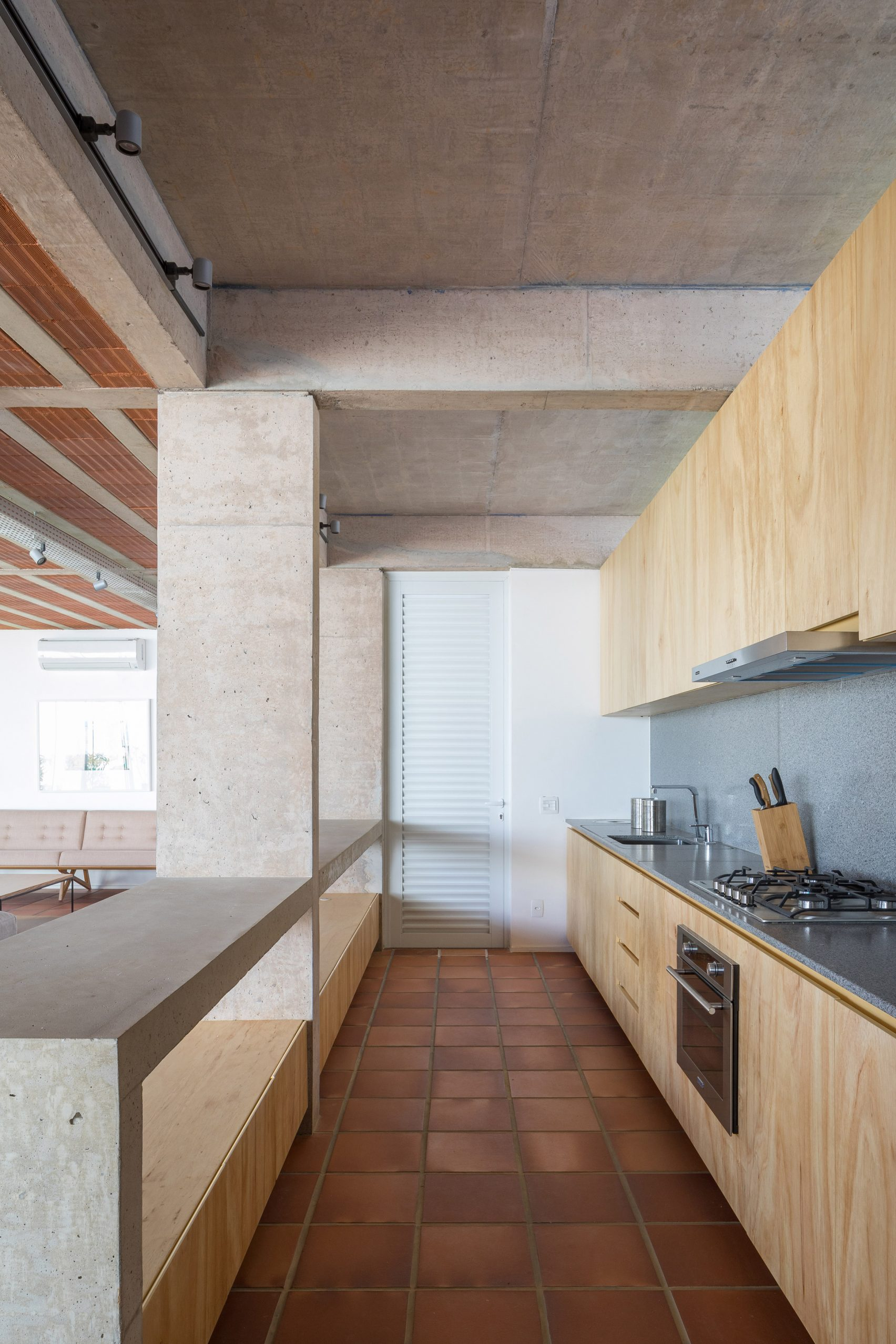 Clay tiles cover the floor of Portico House by Bloco Arquitetos