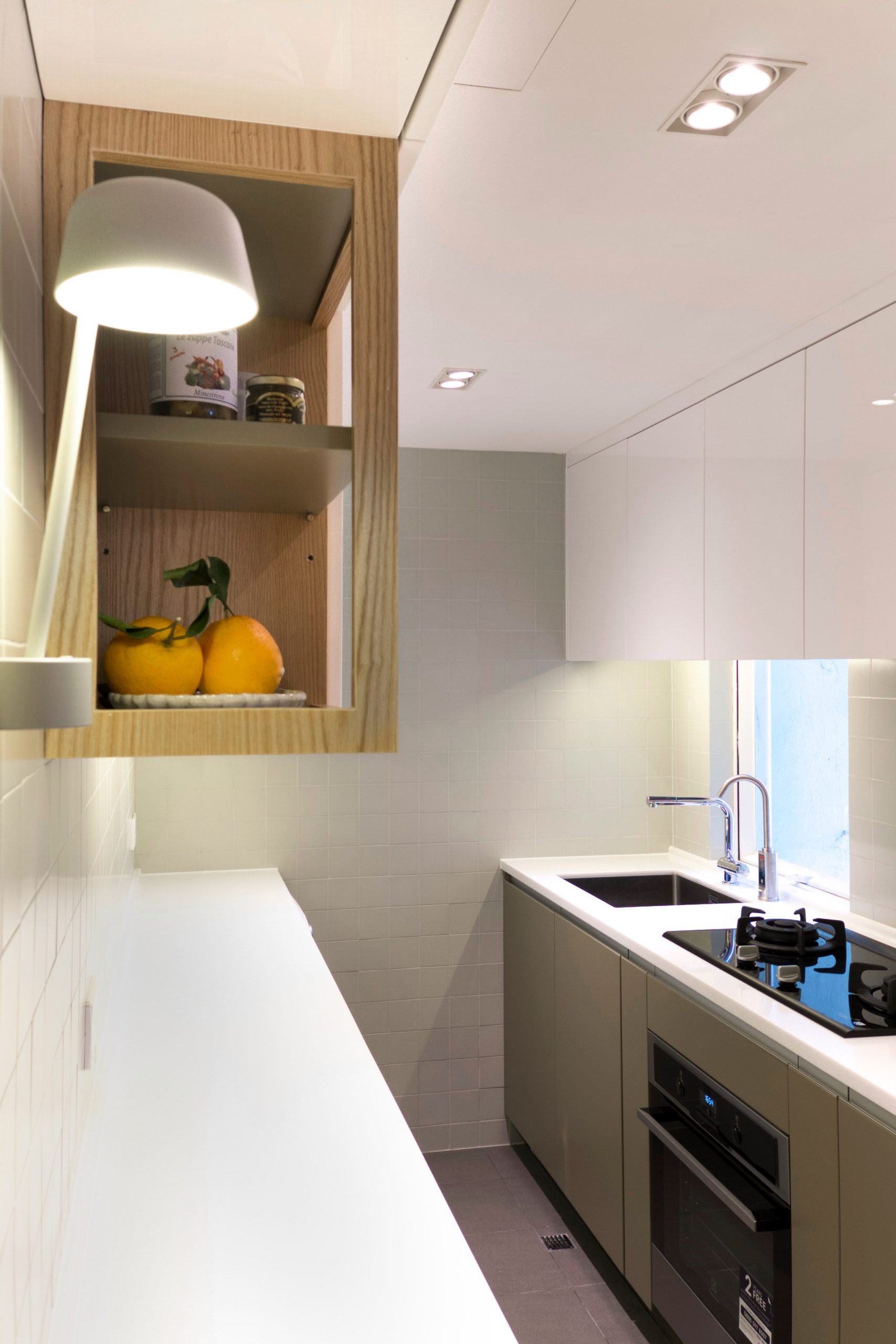 Pale green galley kitchen by Design Eight Five Two