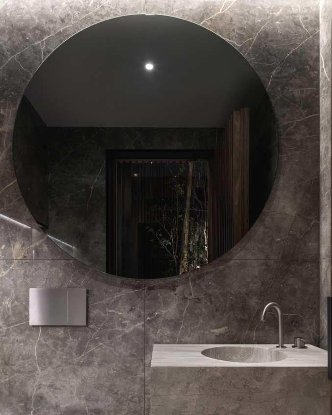 Travertine was used for custom-milled bathroom sinks