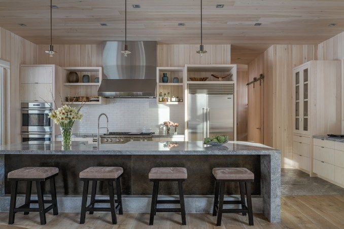 The team used earthy materials in the kitchen