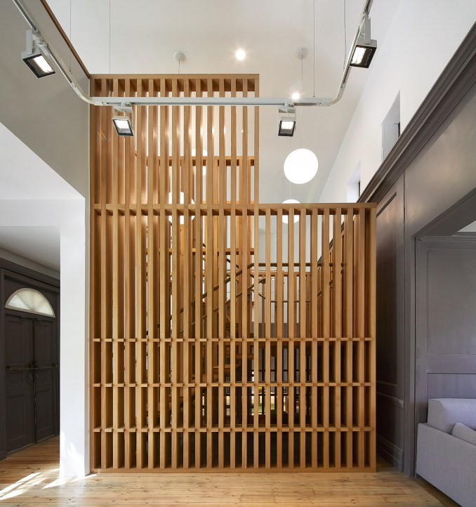 A staircase wrapped in a timber lattice