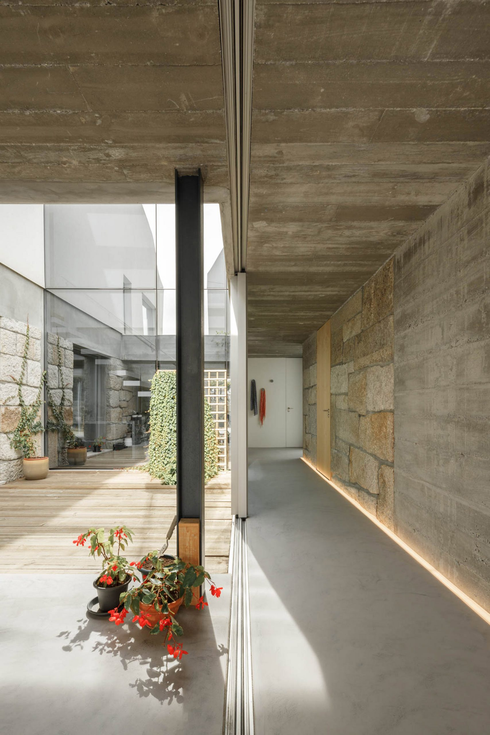 Sliding doors divide the indoors and outdoors