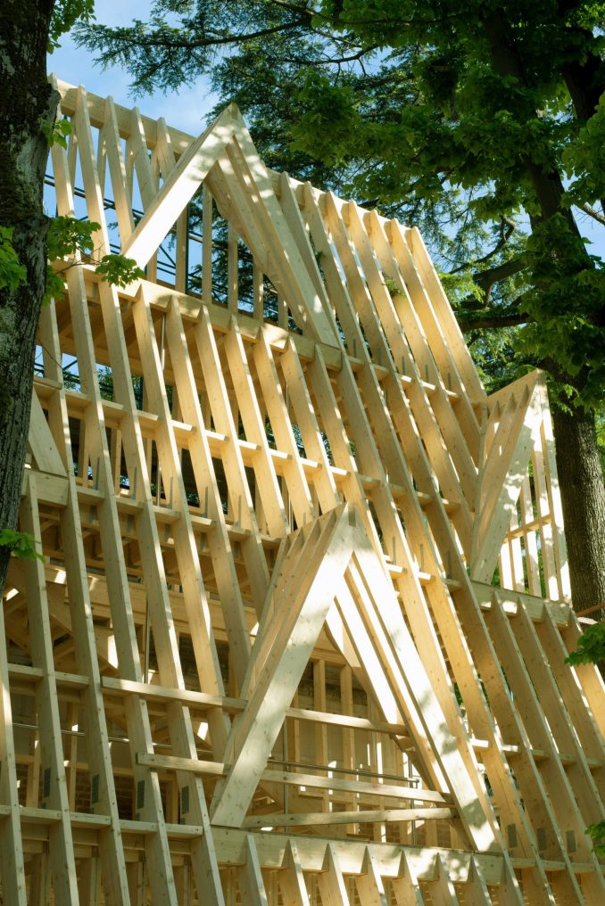 Wood framing shows architecture in progress