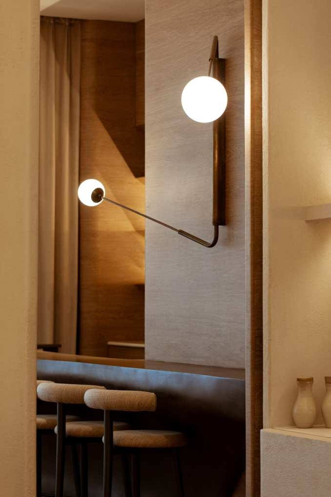 Spherical lights and counter seating in Sequel restaurant interior