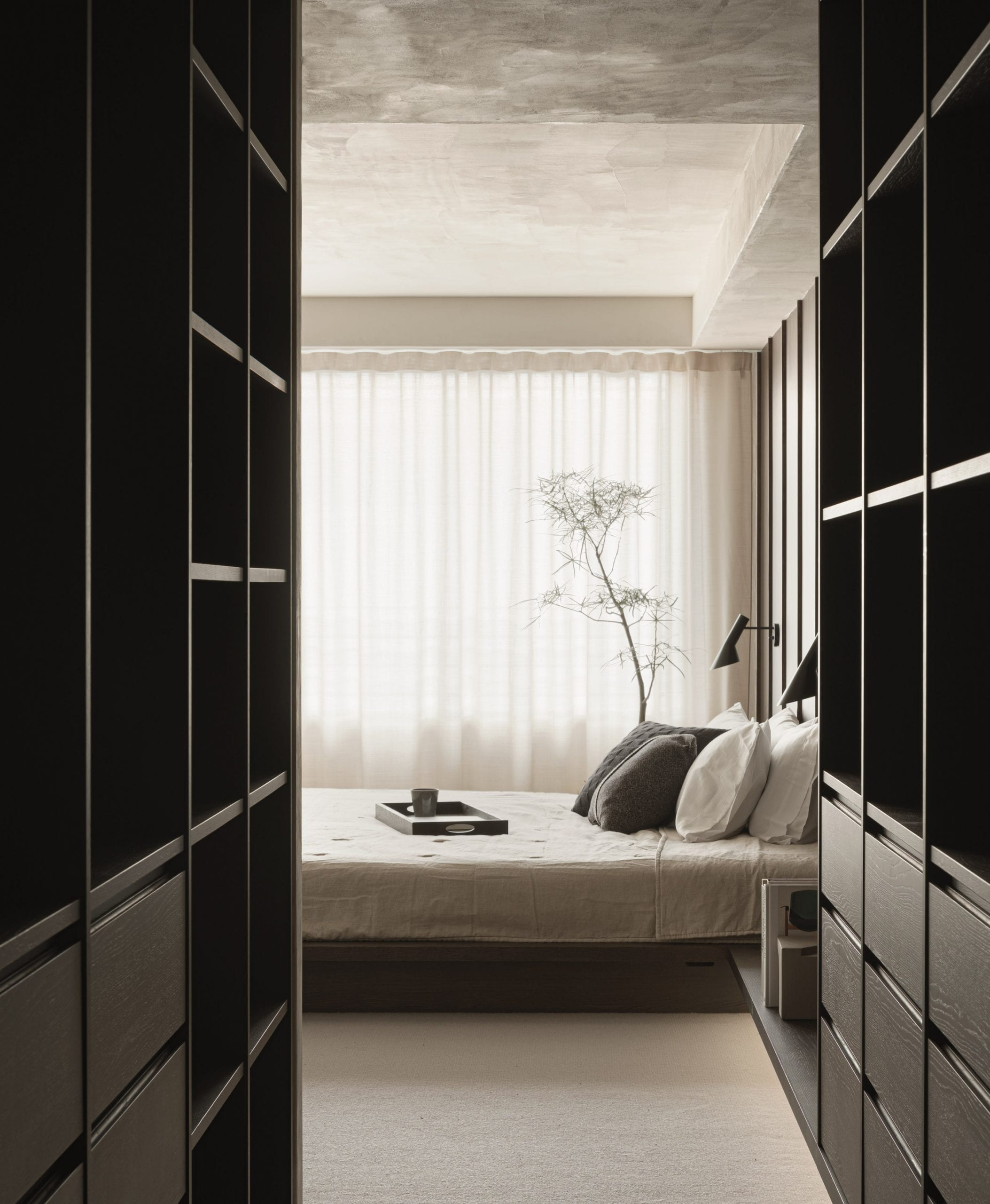 Bedroom storage cabinets in dark wood