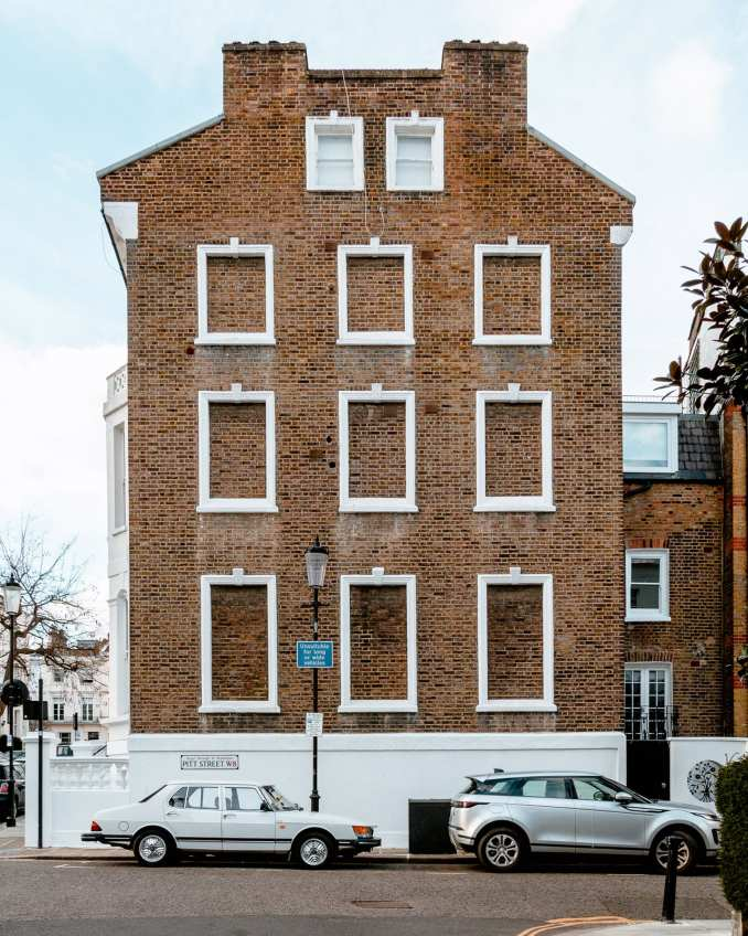 A house with bricked-up windows in London